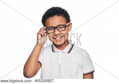 Smiling African American Child With Stylish Eyeglasses, Isolated On White Background. Vision Correct