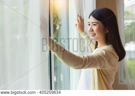 Young Pregnant Mother Wake Up In Early Morning Open Curtain Looking At Nice View Feeling Freshness W