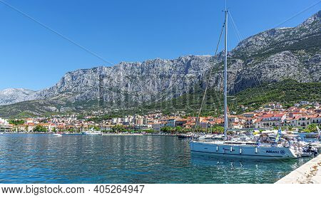 Makarska Riviera, Croatia - 4 July, 2017: View Of The Resort Town Of Makarska In The Summer Day.