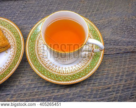 Hot Tea In Vintage Picture Of Antique Hot Tea Cup And Bakery In Saucer On Wood Background  Hot Tea I