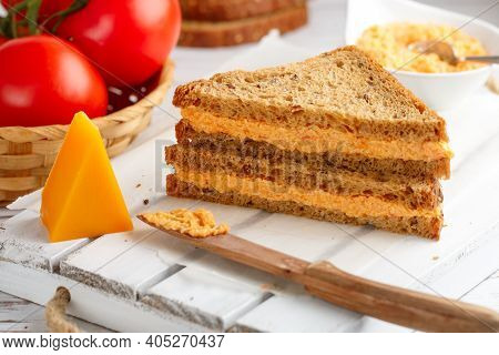 Delicious Sandwiches With Cheddar Cheese, Tomatoes And Onions On Wholewheat Rye Bread With Flax Seed