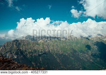 Amazing Mountain Landscape In Summertime. Mighty Mountains In Cloudy Weather.
