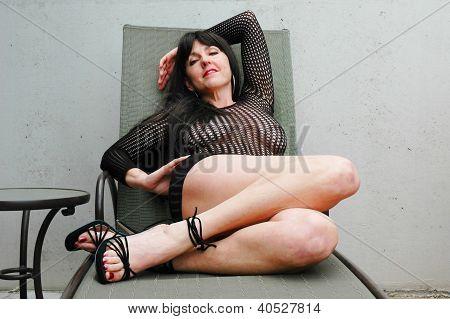 brunette on chair