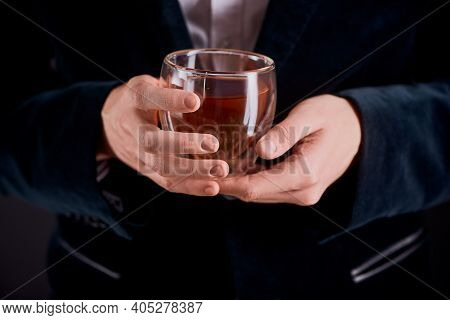 Tea Master Holding A Glass Cup Of Freshly Brewed Herbal Tea