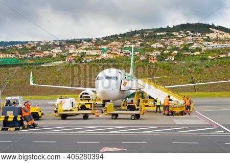 Funchal, Madeira, Portugal - February 12, 2020: Ground Crew Prepare Airplane For Flight At Cristiano