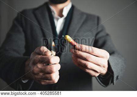 Man Hand Lighting Up A Firecrackers  On Dark Background