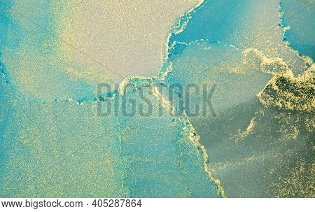 Art Abstract painting blots horizontal background. Alcohol ink blue and gold colors. Marble texture.