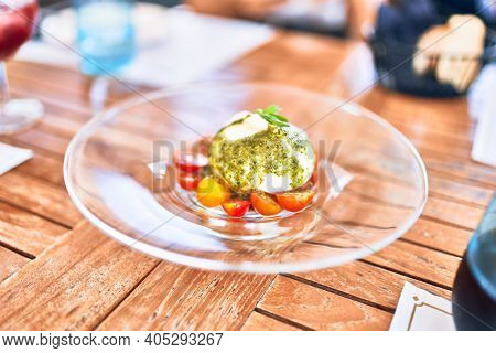 Delicious dish of tomato and burrata cheese salad