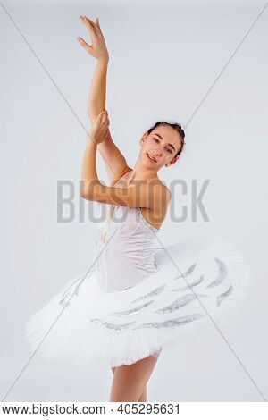 Glory, Dream, Choreography Concept. Slender Figure Of Female Ballet Dancer In The Studio Lights Wear