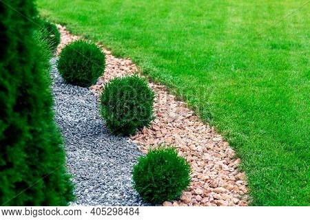 Landscape Bed Of Garden With Wave Ornamental Growth Cypress Bushes Gravel Mulch By Color Rock Way On