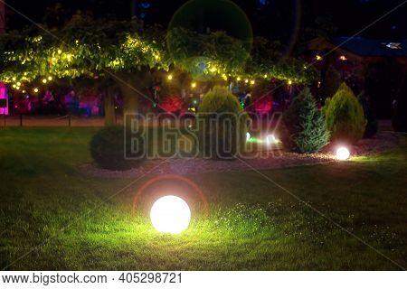 Illumination Park Light Glare  Garden With Electric Ground Ball Lantern With Stone Mulch And Thuja B