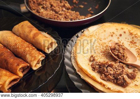 Cooking Homemade Russian Pancakes Bliny With Meat On Shrovetide - Maslenitsa