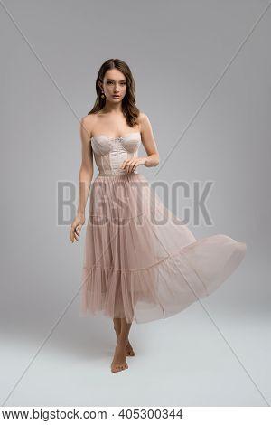 Elegant Slim Woman In Corset And Skirt