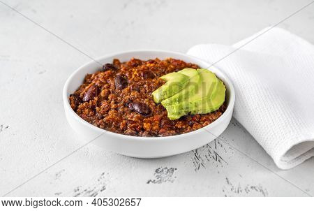 Bowl Of Chili Con Carne With Slices Of Avocado