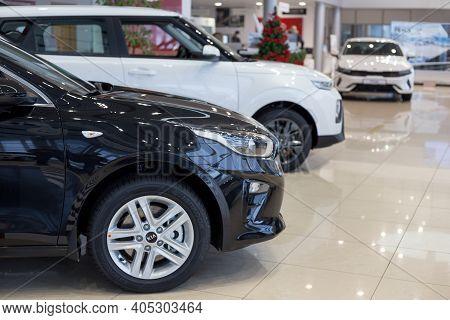 Russia, Izhevsk - December 28, 2020: Kia Showroom. New Modern Cars In Dealer Showroom. Famous World