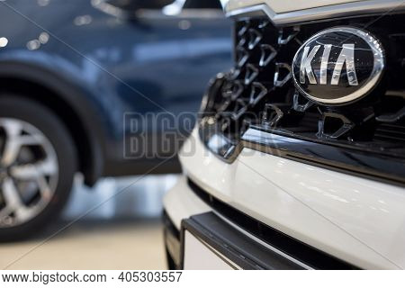 Russia, Izhevsk - December 28, 2020: Kia Logo On A Bumper Of New Car At Dealership Showroom. Famous