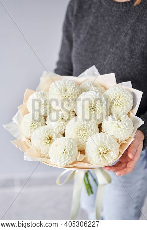 Mono Bouquet Of White Dahlias. Beautiful Bouquet Of Flowers In Womans Hands. The Work Of The Florist