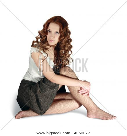 Girl In Short Skirt On White Background