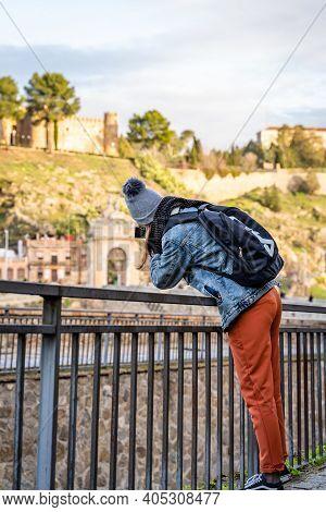Toledo / Spain - January 23rd, 2020 Happy Solo Traveler Taking Photo Of Castillo San Servando Castle