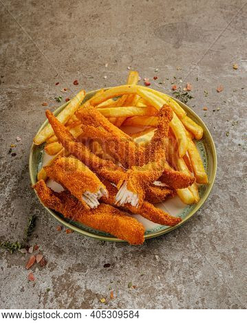 Tasty Ccrunchy Chicken Nuggets With French Fries On Green Ceramic Plate