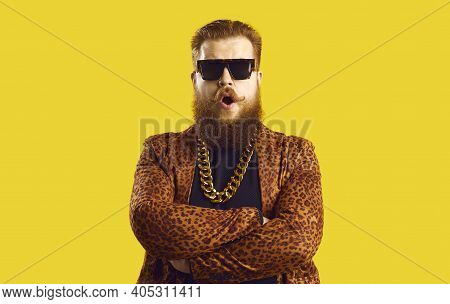 Eccentric Bearded Man In Leopard Print Jacket With Gold Neck Chain Standing Arms Crossed