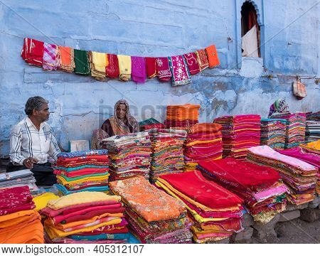 Jodhpur, Rajasthan, India March 20 2017: Vendors Selling Clothes With Vibrant Colors In The Blue Cit