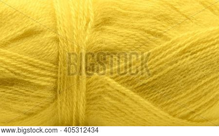 Background, Delicate Yellow Mohair Yarn Wound Into A Ball.