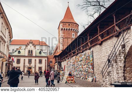 Krakow, Poland - March 8, 2020: St. Florian's Gate, Brama Florianska With Tower And Tourists Walking