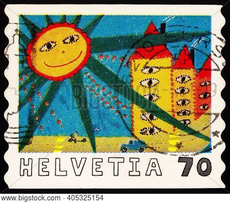 Moscow, Russia - January 27, 2021: Stamp Printed In Switzerland Shows Picture Glances Under The Sun