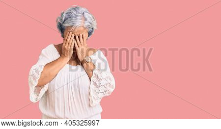 Senior woman with gray hair wearing bohemian style rubbing eyes for fatigue and headache, sleepy and tired expression. vision problem