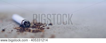 Cigarette Butt On The Floor With Copy Space Background