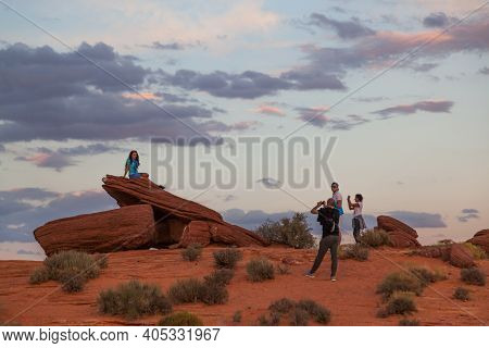 Horseshoe Bend, Arizona / Usa - October 25, 2014:  Tourists Taking Pictures Of A Woman Sitting On An