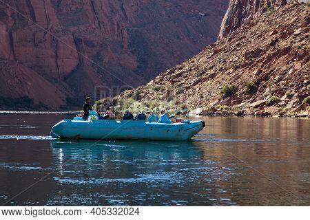 Glen Canyon, Arizona / Usa - October 30, 2014:  A Group Of Tourists On A Rubber Raft To Take A Trip