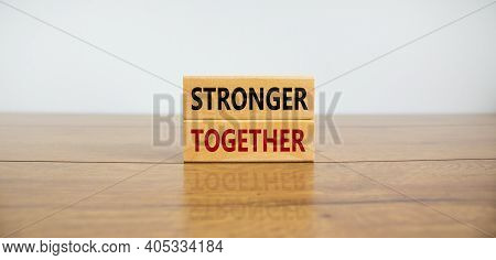 Stronger Together Symbol. Concept Words 'stronger Together' On Wooden Blocks On A Beautiful Wooden T