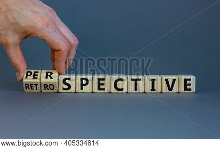Perspective Or Retrospective Symbol. Businessman Hand Turns Cubes And Changes Word 'retrospective' T