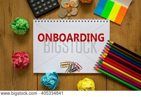 Onboarding Symbol. White Note With A Word 'onboarding' On Beautiful Wooden Table, Colored Paper, Col