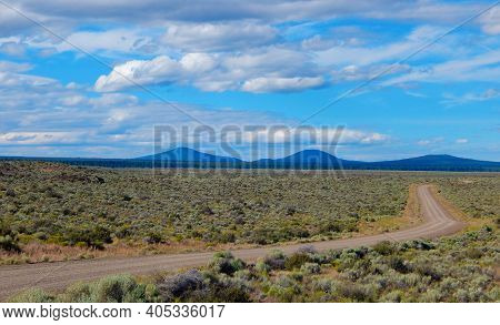 The Distant Hills - A High Desert View Looking North Along China Hat Road With China Hat And East Bu