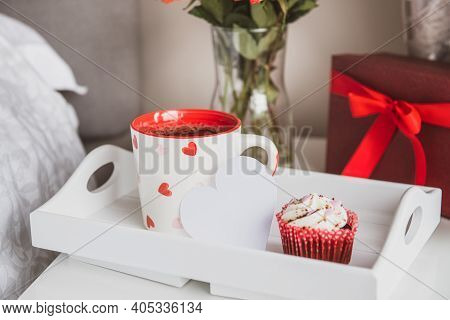 Tray With A Hot Tea Cup, Cupcake, Blank Heart Shaped Card, Gift Box, And A Bouquet Of Flowers In A V