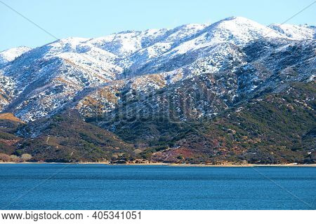 Snow Covered Mountains Surrounding Silverwood Lake, Ca Taken In The Rural Mojave Desert