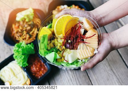 Plastic Box Food Delivery In Take Away Boxes Package On Table At Home, Healthy Food Box In Hand With