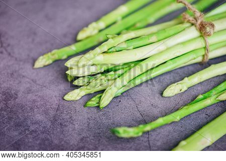 Asparagus Bunch For Cooked Food, Bundle Of Fresh Green Asparagus On A Dark Background
