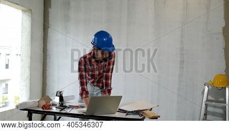 Young Engineer Asian Woman Construction Engineer In Construction Site. Concept Architect And Desk Of