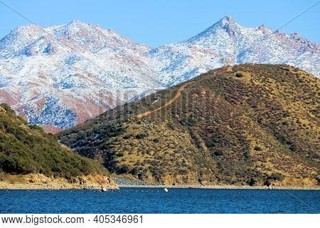 Barren Mountains Covered With Snow Surrounding Silverwood Lake, Ca Taken In The Rural Mojave Desert,
