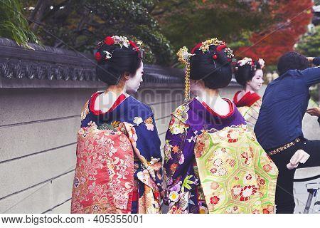 Kyoto, Japan - Dec 6 : Apprentice Geisha,maiko With Umbrella In Kyoto, Japan On December 6,2015. App
