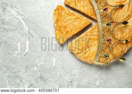 Traditional Galette Des Rois With Decorative Crown On Grey Marble Table, Flat Lay. Space For Text