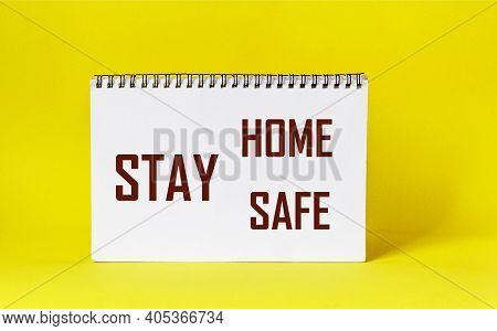 Words Stay Home Stay Safe Written On Notepad And Yellow Background. Self Quarantine At Home Concept