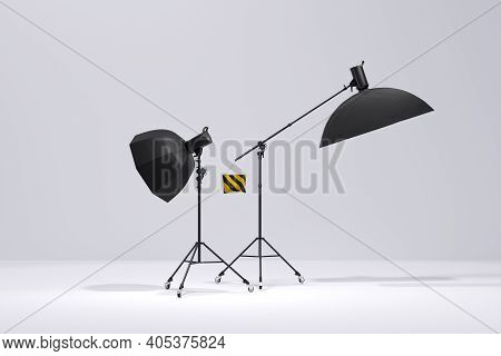 Photo Studio Lighting Stands With Flash And Softbox On The White Background
