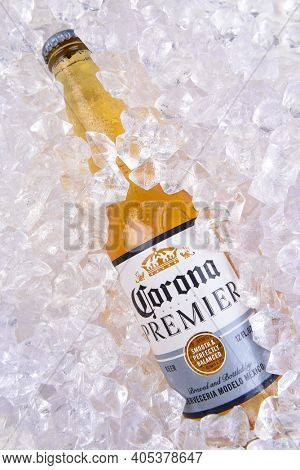 IRVINE, CALIFORNIA - MARCH 29, 2018: Closeup of a Corna Premier beer bottle in ice. Corona Premier is premium light beer with 2.6 grams of carbs and 90 calories.