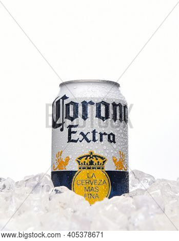 IRVINE, CALIFORNIA - MARCH 21, 2018: 12 counce can of Corona Extra Cerveza in ice. Corona Extra is a pale lager produced by Cerveceria Modelo in Mexico for domestic distribution and export.