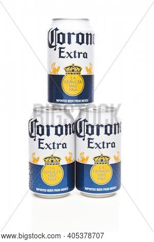 IRVINE, CALIFORNIA - MARCH 21, 2018: Three 12 ounce cans of Corona Extra Cerveza. Corona Extra is a pale lager produced by Cerveceria Modelo in Mexico for domestic distribution and export.